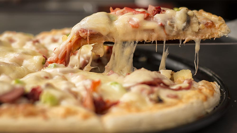 Domino's to Open 9,700 New Stores by 2025, Strengthen Dominance