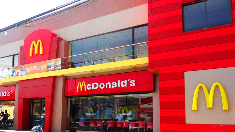 McDonald\'s under pressure to hike wages amid lacklustre sale